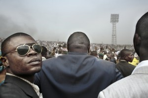 "Guy Tillim Jean-Pierre Bemba surrounded by his body guards walks into an election rally in central Kinshasa, 2006 from the series ""Congo Democratic"" pigment inkjet print on cotton rag paper 49,5 x 72 cm ©Guy Tillim"
